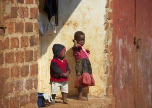 Two Children Standing In a Doorway
