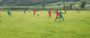 Boys Playing Soccer in Uganda