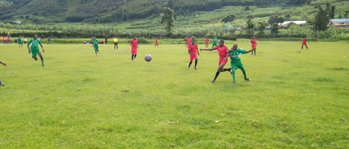 Boys Playing Soccer in Uganda