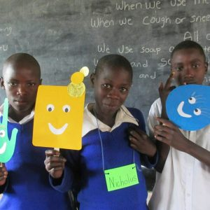 Children Holding Smiley Faces