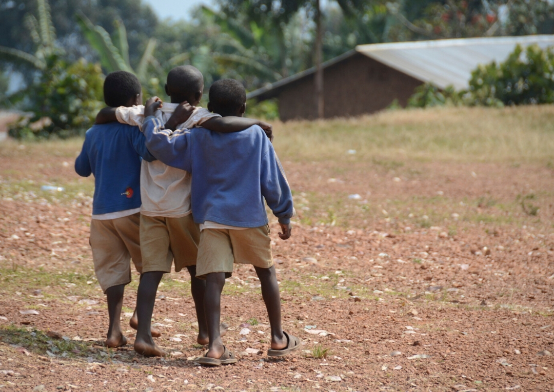 Three Boys Walking Together Down the Road
