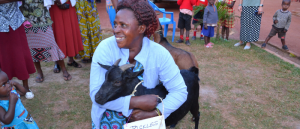 Woman From Cooperative With Donated Goat Named Pickles