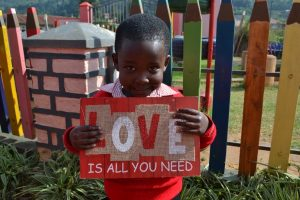 Child Holding Love Sign
